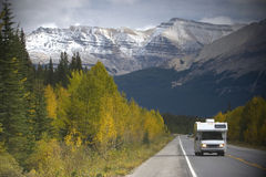 Camper on the road. Scenic travel destination in the mountains Royalty Free Stock Images