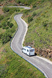 Camping caravan car camper on road Europe european Spain France holiday aerial view trip curvy trailer camp driving travel drive Stock Images
