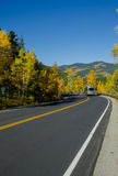 Camper on Road in Fall Royalty Free Stock Image