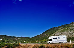 Camper on the road. In Sardinia, Italy Royalty Free Stock Images