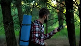 Camper searching for mobile phone signal after lost in woods, bad connection. Stock photo stock photos