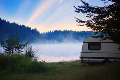 Camper sunrise. RV camper near lake, sunrise in bulgarian nature Royalty Free Stock Photography