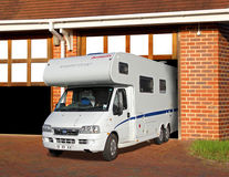 Camper touring van in garage Royalty Free Stock Image