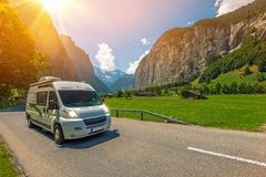 Camper Traveling. Class B Camper Van in European Jungfrau Region in Switzerland. Traveling in Camper Van. RVing in Europe Stock Photo