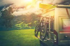 Camper Trip Adventures. Modern Camper Van Motorcoach with Bike and Kayak stock image
