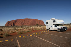 Camper and Uluru Stock Images