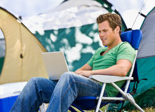 Camper using laptop Stock Photography