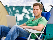Camper using laptop Royalty Free Stock Photo