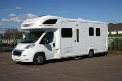 Camper van. White camper van in car park Royalty Free Stock Image