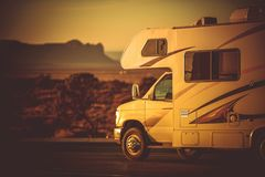 Camper Van Camping. Modern Camper Van Traveling and Camping. Motorcoach in the RV Park Somewhere in the Arizona, United States of America Stock Photos