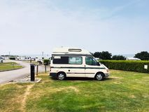 Camper van on campsite with electric hook up in Wales UK Stock Photography