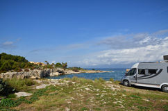 Camper van on the cliff Stock Photo