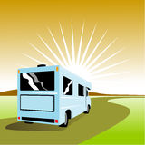 Camper van driving on road Royalty Free Stock Photography