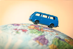 Camper van on a globe Stock Photography