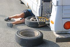 Camper van having a wheel change. By the side of the road royalty free stock photography