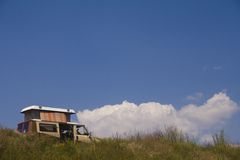 Camper van on hill Royalty Free Stock Photos