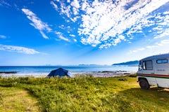 Camper van and tent on beach, Lofoten Norway royalty free stock image