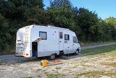 Camper Van. Motorhome using its mobile generator Stock Photos
