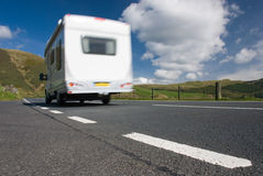 Camper van on mountain road. Wales Royalty Free Stock Photo