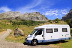 Camper van in mountains blue sky Royalty Free Stock Photography