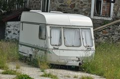 Camper van. Old camper van near a house Royalty Free Stock Photography