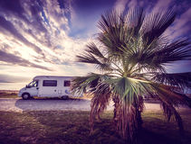 Camper van parked on a beach Royalty Free Stock Image