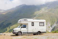 Camper van parked high in the mountains Stock Photo