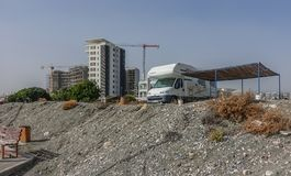 Camper van parked near the beach. St. Barbara, Limassol, Cyprus - November 2, 2018: Camper van parked up besidethe prommendade at the sea front.  Sturdy awing royalty free stock photography