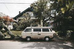 Camper van parked outside house Stock Photo