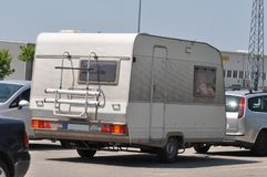 Camper van. On a parking lot near a highway Royalty Free Stock Image