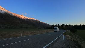 Camper van passing highway in aspiring national park south land new zealand stock video