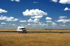 Camper van on Prairie. Camper van travelling across prairie landscape, Alberta Province, Canada Stock Image