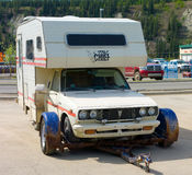 A camper-van resting on a trailer at whitehorse Royalty Free Stock Image