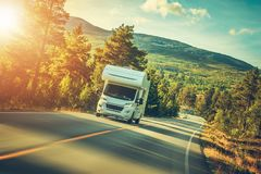 Camper Van Summer Trip. Scenic Norway Landscape and the Recreational Vehicle royalty free stock image