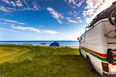 Camper van and tent on beach, Lofoten Norway royalty free stock photography