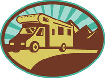 Camper van traveling mountains. Illustration of a Camper van traveling with mountains and sunburst in the background set inside an oval Stock Photos