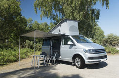 Camper Van Vacation, Holiday Destination. A parked Camper Van set with chair and table stock photo