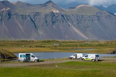 Camper vans at the campsite. Hofn Iceland - August 22. 2018: Camper vans at the campsite royalty free stock photo