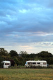 Camper vans under a grey sky in Cheddar Stock Photography