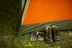 The Campers. Old Dirty Shoes and the Tent. Summer Camp Theme. Horizontal Photo. Campers in Forest stock photography