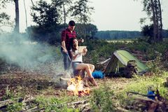 Campers with digital tablet. Happy young campers with digital tablet royalty free stock image