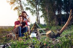 Campers with digital tablet. Young happy campers with digital tablet royalty free stock photos