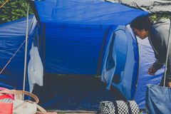 Campers set up a nylon tent. Campers setting  up a nylon tent in a Camping holidays close to Bristol, England royalty free stock image