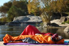 Campers in sleeping bags outdoors. Professional equipment royalty free stock photos