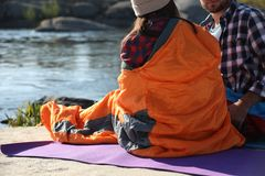 Campers in sleeping bags outdoors. Space for text royalty free stock photos