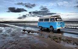 Campervan driving along beach