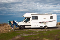 Campervan at ocean coast Stock Photo