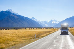 Campervan on road with mountain view. Campervan on road with Mount Cook view background, New Zealand royalty free stock photography