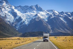 Campervan on road with mountain view. Campervan on road with Mount Cook view background, New Zealand royalty free stock photos