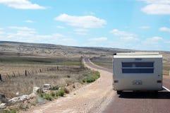 Campervan sulla strada Fotografia Stock
